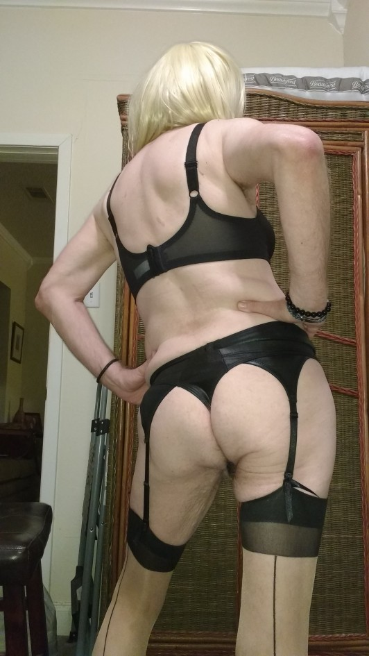 sexy blonde wearing black bra, black garter belt & black seamed stocking with black thong what more is there to say except total sexy. How like my ass