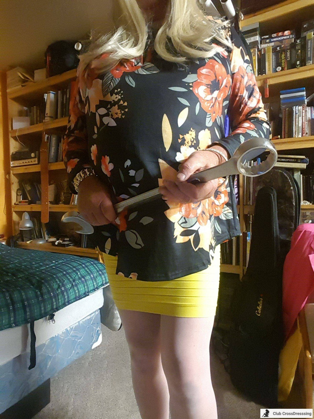 Brianna-Leah gets started on her working day with a very big wrench or spanner