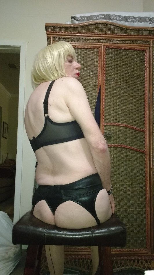 sexy blonde wearing black bra, black garter belt & black seamed stocking with black thong what more is there to say except total sexy