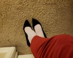 Red pants, white hose, black heels